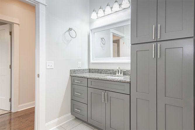 Gray bathroom vanity installation